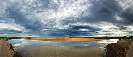 moray: Early morning light, with dramatic cloud formations over Lossiemouth harbour, Moray Firth, Scotland