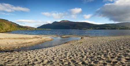 loch: Panorama of a small shingle beach at the edge of Loch Lomond, Scotland