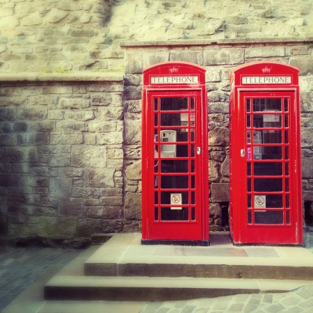 A pair of traditional British red phone boxesagainst  photo
