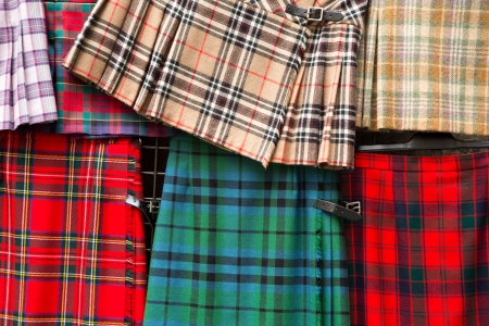 Detail of a variety of tartan kilts