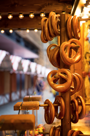 Fresh pretzels displayed on a wooden stand, at a German Christmas market. photo