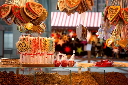 Gingerbreads, candies and nuts displayed on a Christmas market stall in Berlin, Germany Archivio Fotografico