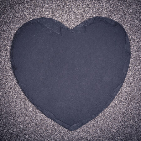 blank slate: A slate heart over a speckled background with space for your text