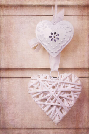chest of drawers: A wicker and a tin heart hanging from the knob of a chest of drawers  Vintage effect with added texture