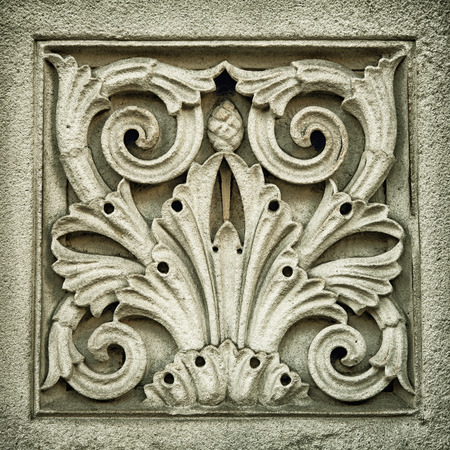 symetry: Bas-relief panel on the exterior of a building in London. Retro style processing with vignette.