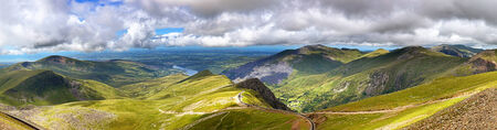 Panorama of the mountains of Snowdonia, looking from Mount Snowdon along the mountain railway track towards the town of Llanberis photo
