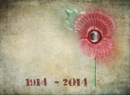 world war two: Graffiti style remembrance day poppy on grunge background  Dates on 1914-2014 in stencil style to commemorate the Centenary of World War One  Stock Photo