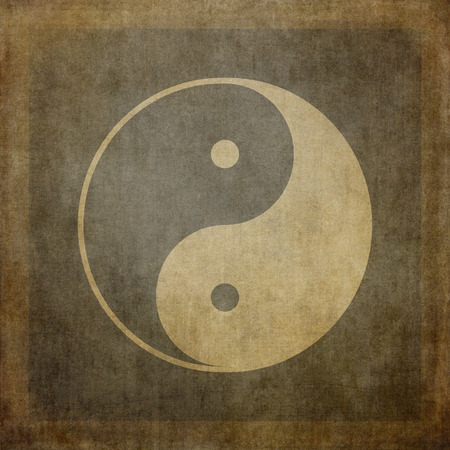 Yin yang symbol on vintage, textured background