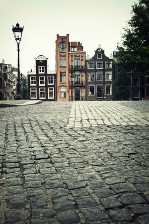 Street scene showing traditional architecture, Amsterdam. Filtered to look like an aged instant photo. photo