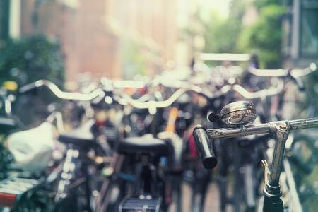 dozens: Dozens of parked bikes in an Amsterdam street
