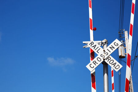 cross: Railroad crossing sign against blue sky background, with space for your text. Stock Photo