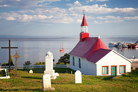 lawrence: Chapel of Tadoussac, historical monument built of wood in 1747. The red-roofed Chapel overlooks the St Lawrence river. Quebec, Province, Canada. Stock Photo