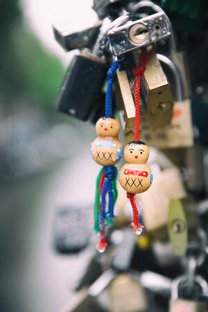 locks: Love locks in the rain with traditional wooden symbols of Amsterdam .
