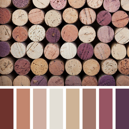 A background of wine corks in a colour palette, with complimentary colour swatches