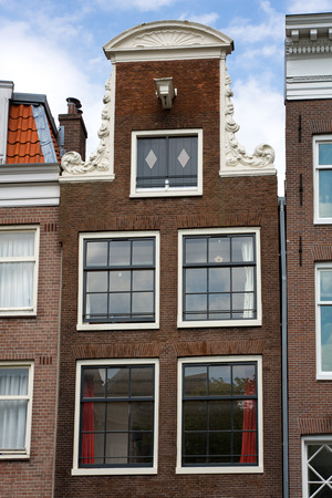 merchant: Typical merchant house facade in Amsterdam, Netherlands. Stock Photo