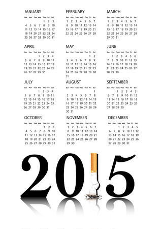 replaced: New Year resolution Quit Smoking Calendar with the 1 in 2015 being replaced by a stubbed out cigarette. Stock Photo