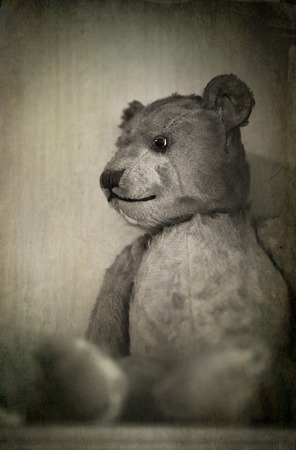 well loved: Nostalgic image of an old, well loved bear. Sepia effect with texture.