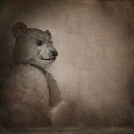 vintage teddy bears: Nostalgic image of an old, well loved bear. Sepia effect with texture and space for text Stock Photo
