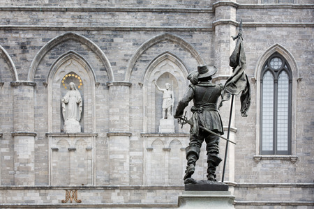 verdigris: Detail of the exterior of the Basilica Notre Dame, with statue of Paul de Chomedey de Maisonneuve, founder of Montreal. In Old Town, Montreal, Canada.