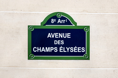 street name sign: The Avenue des Champs Elysees street sign,  situated in the 8th arrondissement of Paris, France. One of the most famous streets in the world. Stock Photo