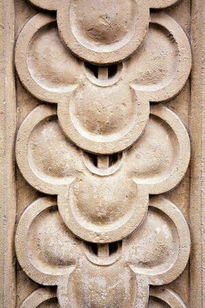 stonemasonry: Architectural detail. Carved overlap pattern, ancient stonemasonry. Stock Photo