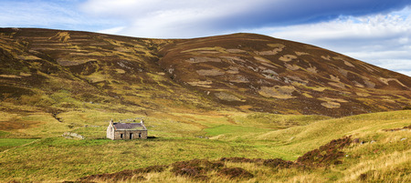 croft: Panorama of the Cairngorms, Scottish Highlands, Scotland, UK. Panoramic view including derelict stone cottage.