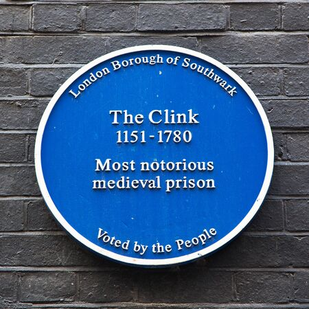 blue plaque: LONDON, UK - AUGUST 11: Blue Plaque commemorating the site of the notorious medieval prison The Clink, which functioned between the 12th and 18th centuries.  On Bankside, London, August 11 2012