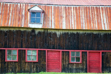 worn structure red: Detail of the side facade of a traditional old barn in Canada. Stock Photo
