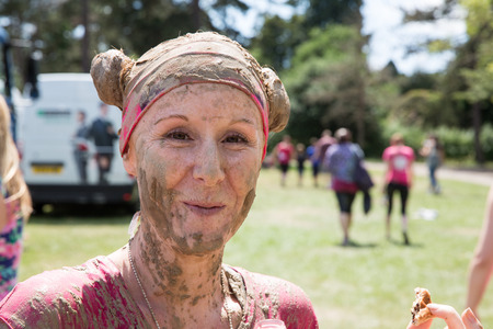 uk money: SOUTHAMPTON, UK - JULY 4 : Women gather for the annual Race for Life Pretty Muddy fun run, to raise money for Cancer Research. 4 July 2015 in Southampton, UK.