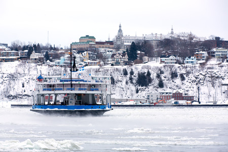 lawrence: Passenger Ferry crosses the frozen St Lawrence river, Quebec City, Canada. Identifying marks removed.