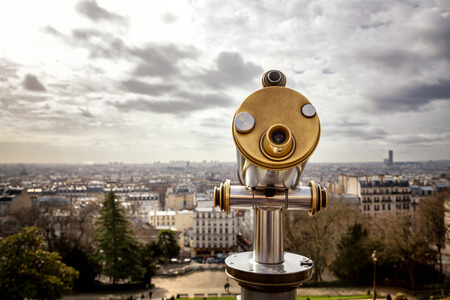 positioned: Tourist telescope positioned above the city of Paris. The view is from The Sarcre Coeur in Montmartre Stock Photo