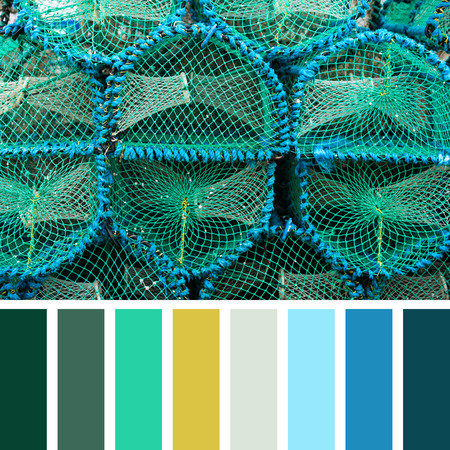 lobster pot: Stacked lobster pots in a colour palette with complimentary colour swatches. Stock Photo