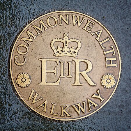 commemorative: Commemorative Commonwealth Walkway brass plaque. Street sign set in the pavement, Glasgow, Scotland, UK Editorial