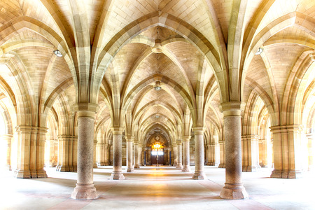 university building: Sunlight streams into the historic Cloisters of Glasgow University. Subtle HDR processing. Stock Photo