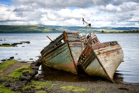 abandoned: Two abandoned fishing boats in Salen Sound, Isle of Mull, Inner Hebrides, Scotland.