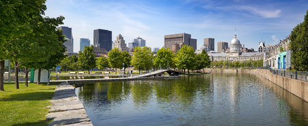 Summer panorama of downtown Montreal viewed from the park, showing the old Bonsecours Market building, which was the public city market for over 100 years.