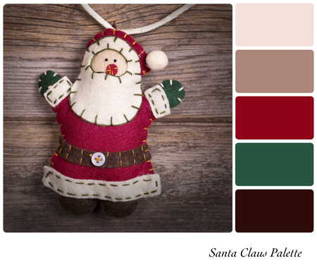 complimentary: Retro style felt Santa Claus over old wood background. In a colour palette with complimentary colour swatches. Stock Photo