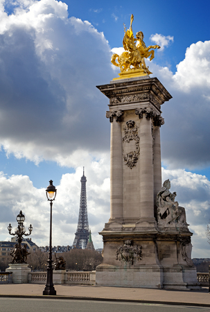 alexandre: Column with gilded sculpture on the Pont Alexandre III bridge with the Eiffel Tower in the background. Paris, France. Stock Photo