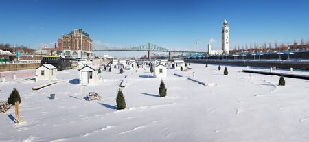 fishing hut: A panorama of the frozen St Lawrence river  and Jacques Cartier Bridge in downtown Montreal. In winter, temporary fishing huts are erected on the ice. Stock Photo