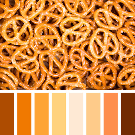 complimentary: A background of salted pretzels. In a colour palette with complimentary colour swatches.