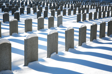 unmarked: Uniform rows of unmarked graves in the snow, Montreal, Canada.
