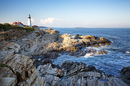 rocky coastline: Portland Head lighthouse with the rocky coastline in the foreground. Stock Photo