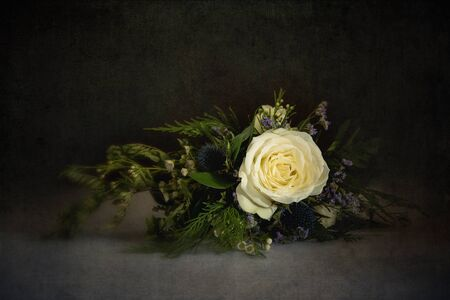 rose bouquet: Simple bouquet featuring single white rose. Textured and filtered in antique style. Stock Photo