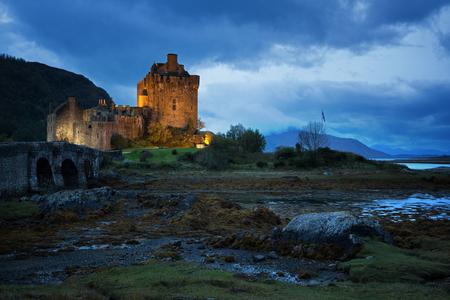 kyle: The illuminated Eilean Donan  during blue hour. Loch Duich, Scottish Highlands.