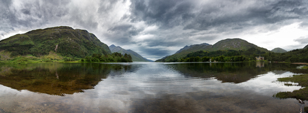 the jacobite: Highland panorama mirrored in the calm waters of Loch Shiel, Glenfinnan, Scotland, UK