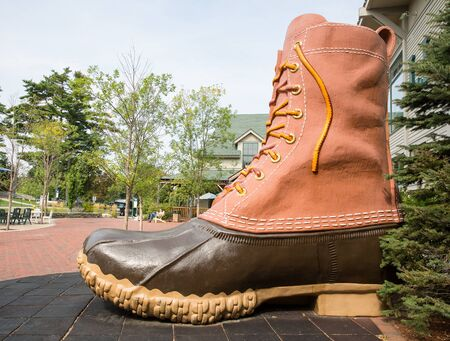 flagship: FREEPORT, MAINE, USA-AUG 31st, 2014: L.L. Bean is retail company founded in 1912 by Leon Leonwood Bean. A replica of its famous boot stands outside the flagship store.