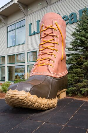 freeport: FREEPORT, MAINE, USA-AUG 31st, 2014: L.L. Bean is retail company founded in 1912 by Leon Leonwood Bean. A replica of its famous boot stands outside the flagship store.