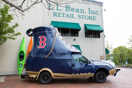 flagship: FREEPORT, MAINE, USA-AUG 31st, 2014: L.L. Bean is retail company founded in 1912 by Leon Leonwood Bean. A replica of its famous boot has been coverted to a promotional vehicle and stands outside the flagship store.