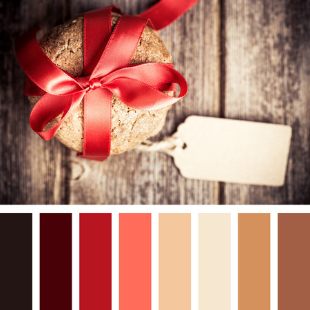 complimentary: Cookie gift with tag over old wood background. In a colour palette with complimentary colour swatches