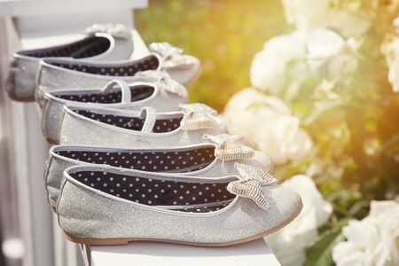 sparkly: Sparkly bridesmaid shoes lined up in the sunlight. Stock Photo
